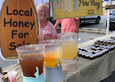 Carol of Honey Bee Lake Apiaries sells refreshing drinks